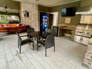 Two Bedroom Apartments for Rent in The Woodlands, TX - Outdoor Covered Grilling Area with Seating