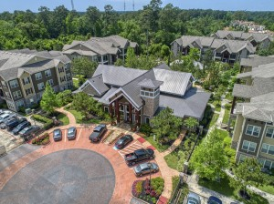 Two Bedroom Apartments for Rent in The Woodlands, TX - Aerial View of Entrance to Leasing Office and Exterior Buildings